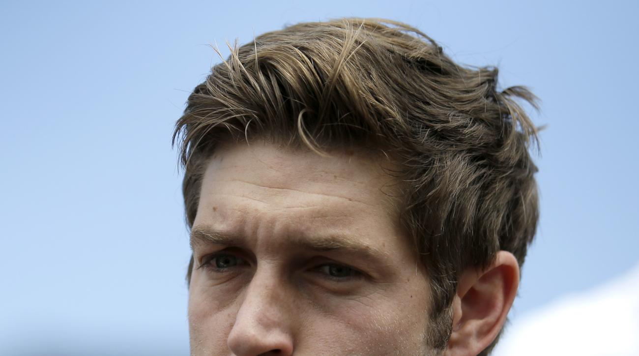Chicago Bears quarterback Jay Cutler listens to a reporter's question during an NFL football training camp media availability at Olivet Nazarene University, Wednesday, July 29, 2015, in Bourbonnais, Ill. (AP Photo/Nam Y. Huh)