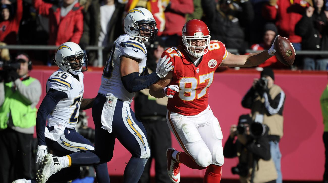 FILE - In this Dec. 28, 2014, file photo, Kansas City Chiefs tight end Travis Kelce (87) scores a touchdown after recovering a fumble by teammate wide receiver Dwayne Bowe (not shown) as San Diego Chargers inside linebacker Manti Te'o, center, and cornerb