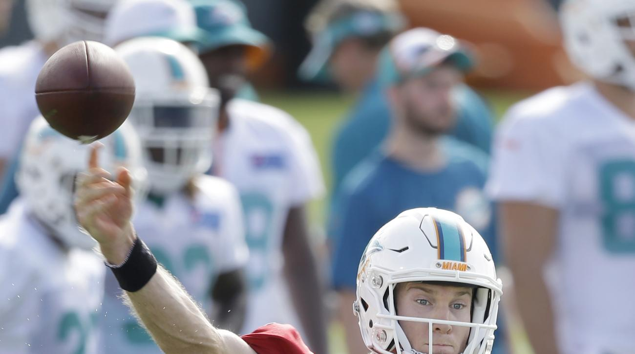 Miami Dolphins quarterback Ryan Tannehill throws a pass at the teams NFL football training camp, Thursday, July 30, 2015, in Davie, Fla. (AP Photo/Wilfredo Lee)