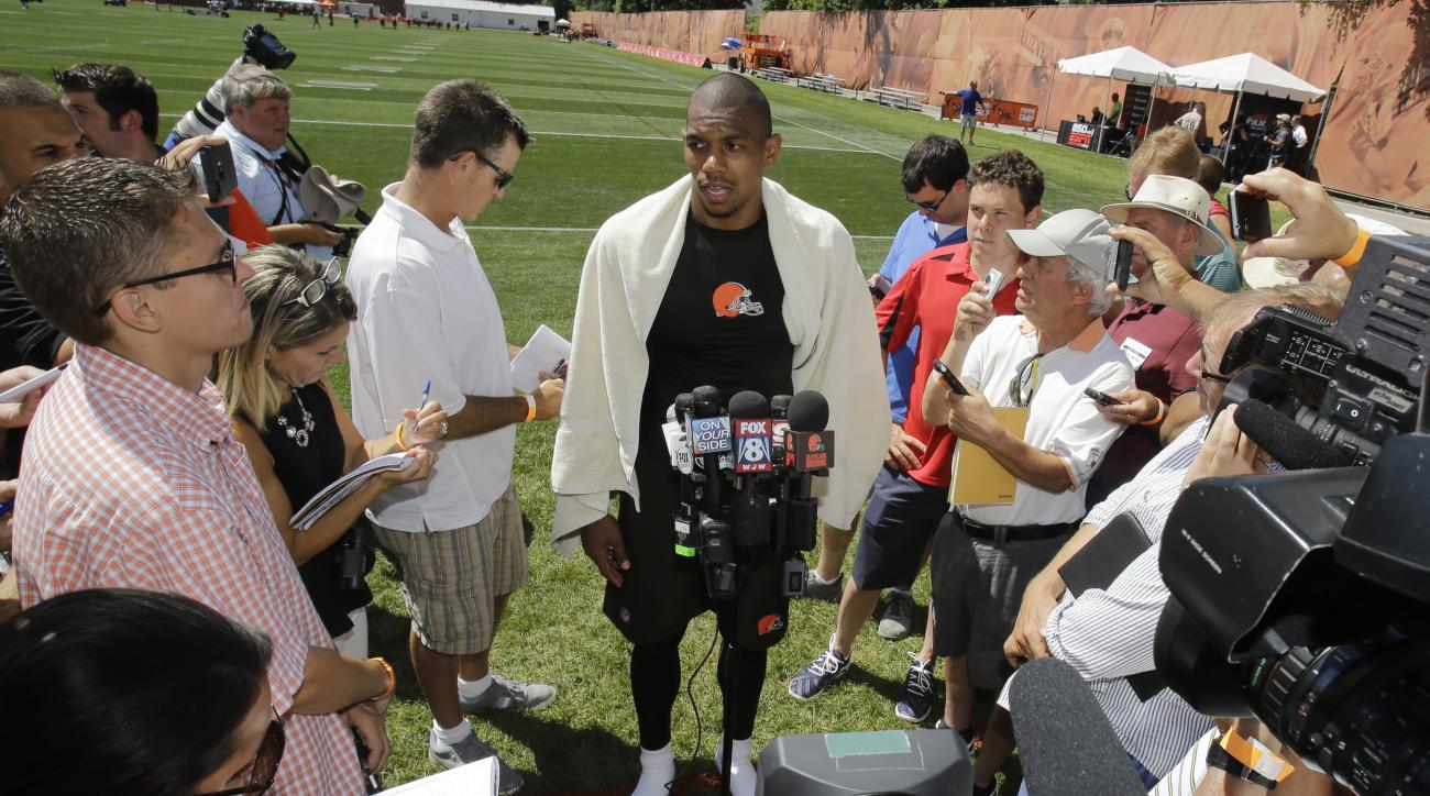 Cleveland Browns wide receiver Terrelle Pryor talks with the media after practice at the NFL football team's training camp Thursday, July 30, 2015, in Berea, Ohio. Pryor has been a quarterback his entire football life, but the gifted athlete is swtiching