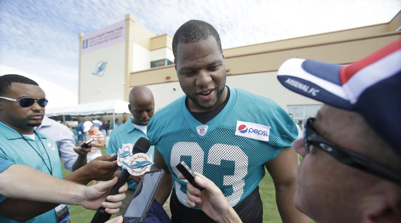 Miami Dolphins defensive tackle Ndamukong Suh speaks to members of the media after the teams NFL football training camp, Thursday, July 30, 2015, in Davie, Fla. (AP Photo/Wilfredo Lee)