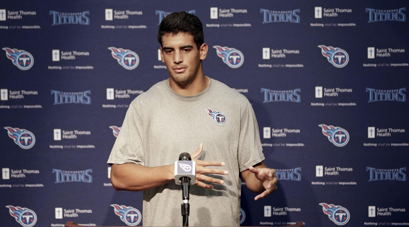 Tennessee Titans quarterback Marcus Mariota answers questions during a news conference Thursday, July 30, 2015, in Nashville, Tenn. The Titans, who had a 2-14 record last season, begin NFL football training camp Friday. (AP Photo/Mark Humphrey)