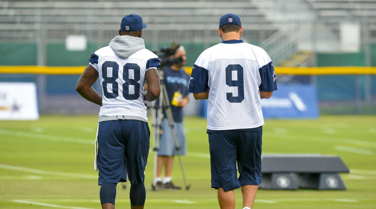 Dallas Cowboys wide receiver Dez Bryant (88) and quarterback Tony Romo (9) take the field during Dallas Cowboys NFL football training camp, Thursday, July 30, 2015, in Oxnard, Calif. (AP Photo/Gus Ruelas)