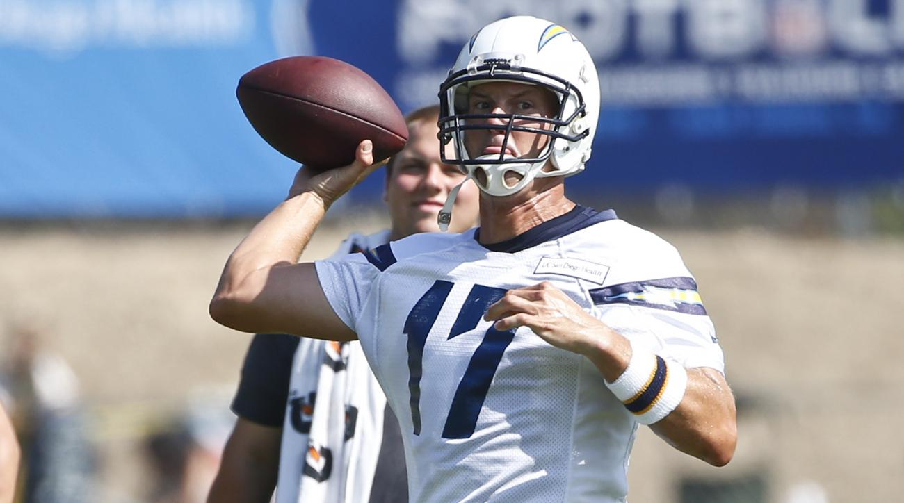 San Diego Chargers quarterback Philip Rivers throws a pass during drills at opening day of training camp at Chargers' Park Thursday, July 30, 2015, in San Diego. (AP Photo/Lenny Ignelzi)