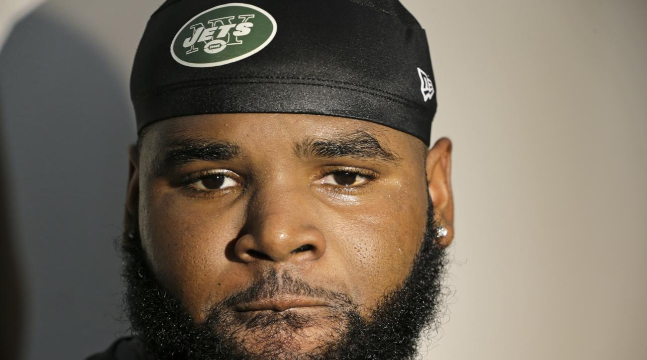 New York Jets defensive end Sheldon Richardson responds to questions during a news interview after practice at training camp, Thursday, July 30, 2015, in Florham Park, N.J. (AP Photo/Frank Franklin II)