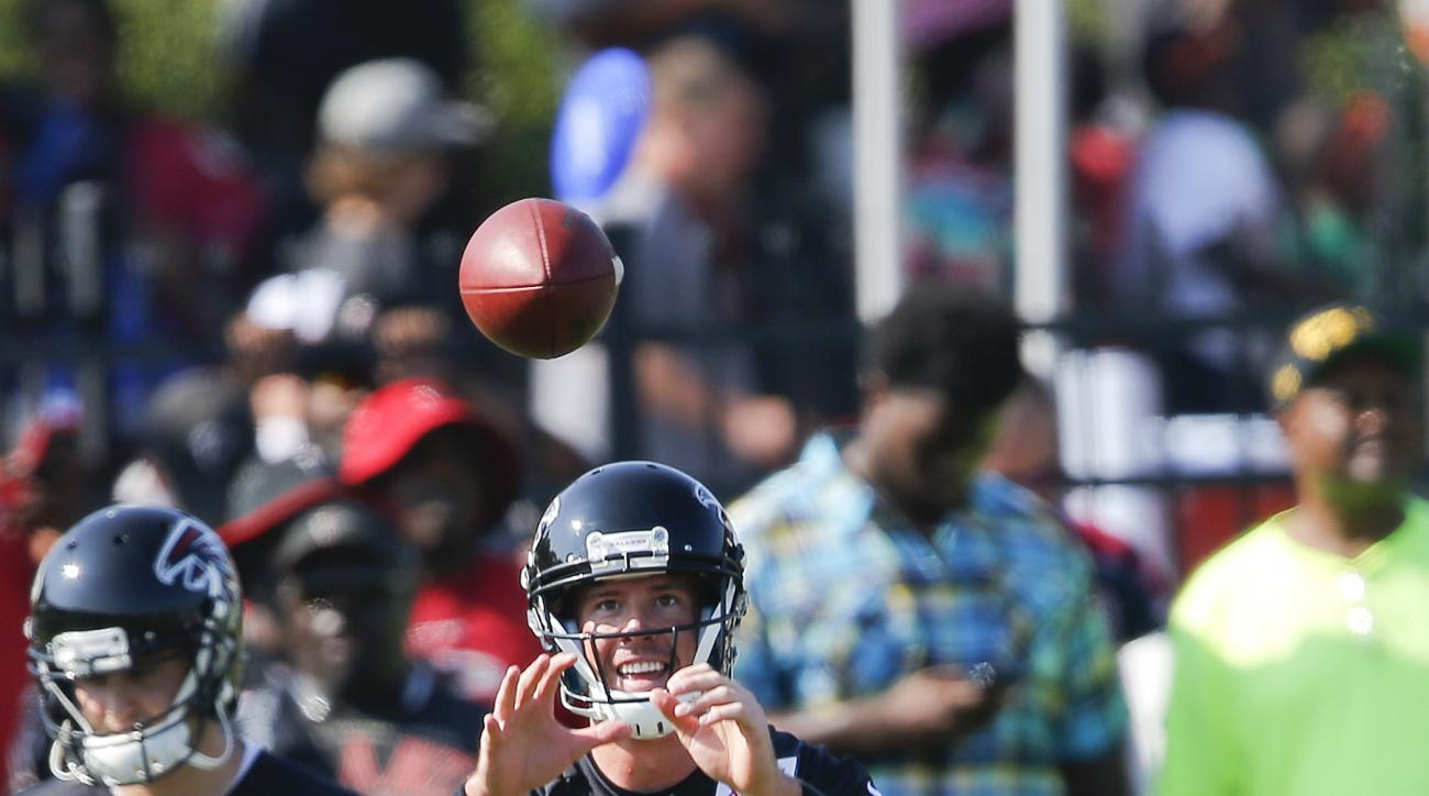 Atlanta Falcons quarterback Matt Ryan (2) works during an NFL football training camp  Friday, July 31, 2015, in Flowery Branch, Ga. (AP Photo/John Bazemore)