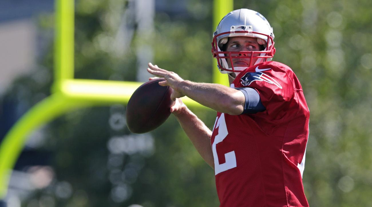New England Patriots quarterback Tom Brady throws during an NFL football training camp in Foxborough, Mass., Friday, July 31, 2015. (AP Photo/Charles Krupa)