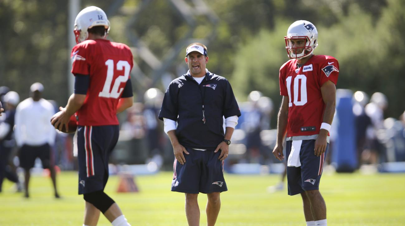 New England Patriots offensive coordinator Josh McDaniels talks with quarterbacks Tom Brady, left, and Jimmy Garappolo during an NFL football training camp in Foxborough, Mass., Friday, July 31, 2015. (AP Photo/Charles Krupa)