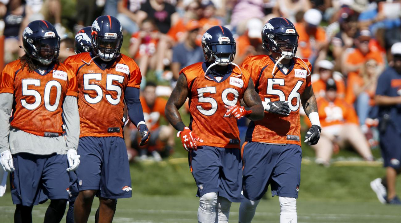 From left, Denver Broncos linebackers Reggie Walker, Lerentee McCray, Danny Trevathan and Shane Ray take part in a running drill at the team's NFL football training camp Friday, July 31, 2015, in Englewood, Colo. (AP Photo/David Zalubowski)