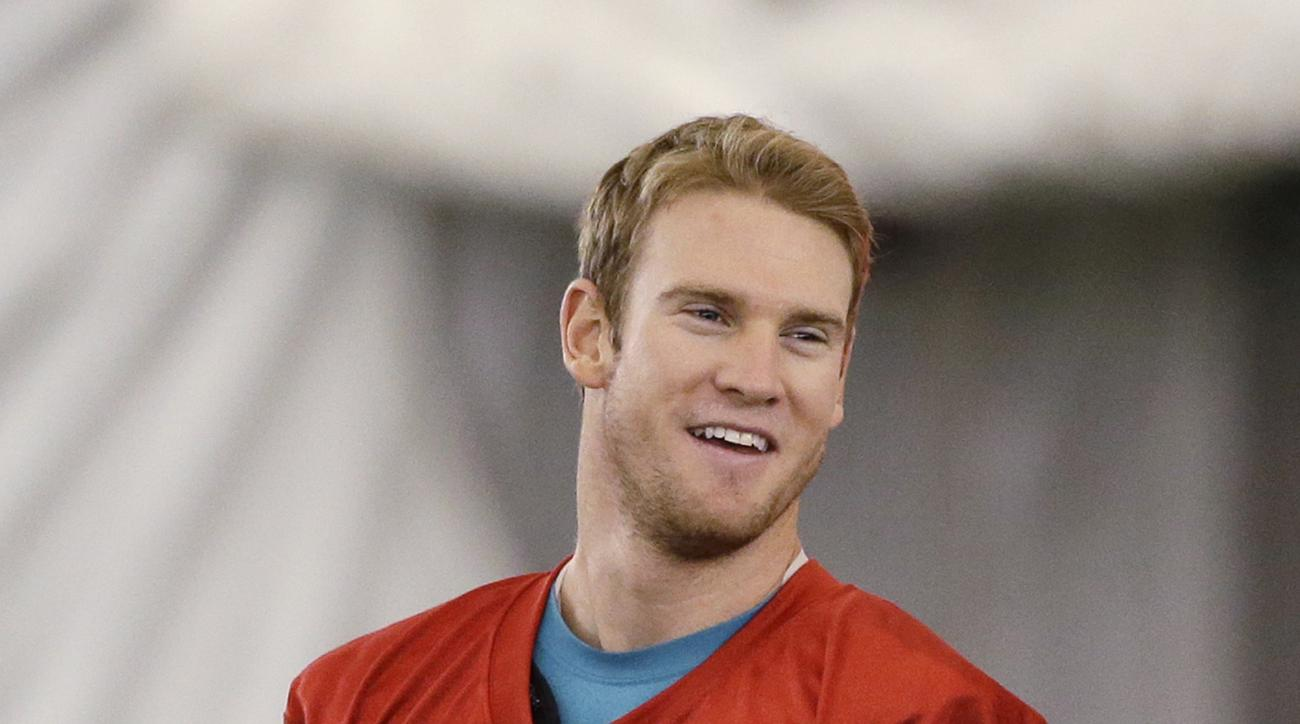 In this Thursday, July 30, 2015 photo, Miami Dolphins quarterback Ryan Tannehill smiles at the teams NFL football training camp, in Davie, Fla. Ryan Tannehill has been smiling throughout the first two days of Miami Dolphins training camp, a combination of