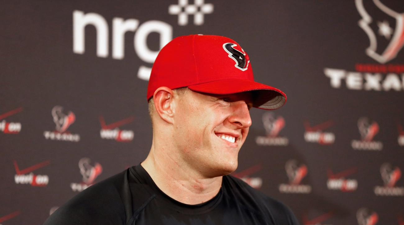 Houston Texans defensive end J.J. Watt fields questions from the media during a press conference on Friday, July 31, 2015, in Houston. The Houston Texans open training camp Aug. 1, 2015. (AP Photo/Bob Levey)