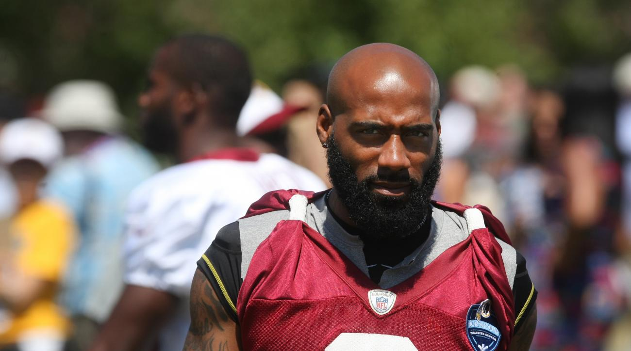 Washington Redskins cornerback DeAngelo Hall walks the sidelines during the teams NFL football training camp in Richmond, Va., Friday, July 31, 2015.  (AP Photo/Jason Hirschfeld)