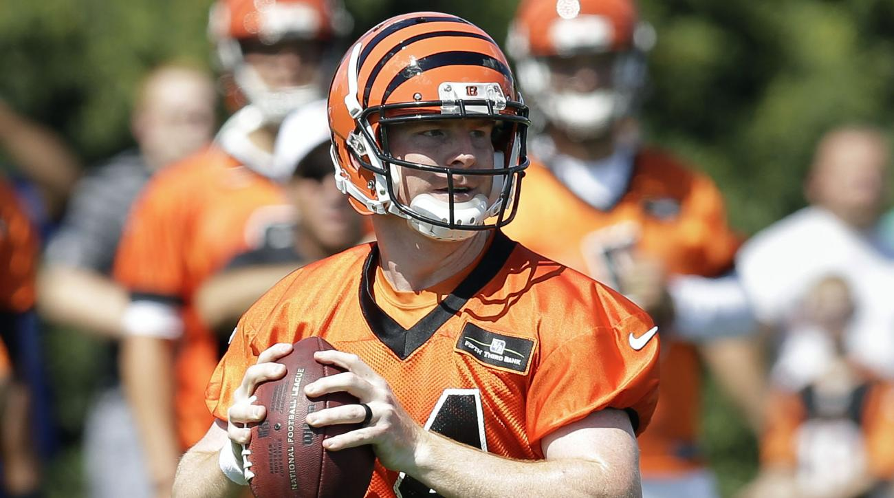 Cincinnati Bengals quarterback Andy Dalton participates in NFL football training camp, Friday, July 31, 2015, in Cincinnati. (AP Photo/John Minchillo)
