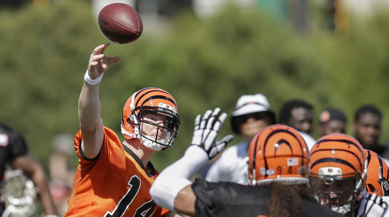 Cincinnati Bengals quarterback Andy Dalton (14) participates in NFL football training camp, Friday, July 31, 2015, in Cincinnati. (AP Photo/John Minchillo)