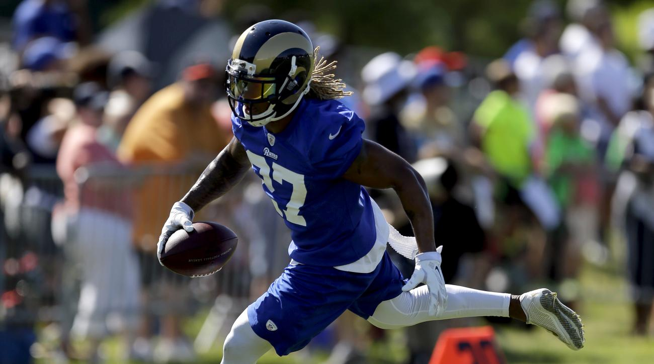 St. Louis Rams running back Tre Mason runs with the ball during training camp at the NFL football team's practice facility Friday, July 31, 2015, in St. Louis. (AP Photo/Jeff Roberson)