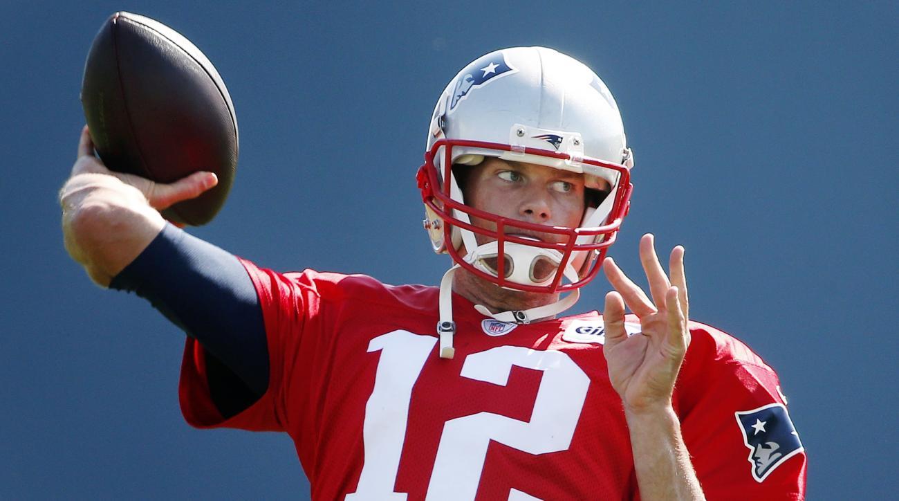 New England Patriots quarterback Tom Brady passes during an NFL football training camp in Foxborough, Mass., Saturday, Aug. 1, 2015. (AP Photo/Michael Dwyer)