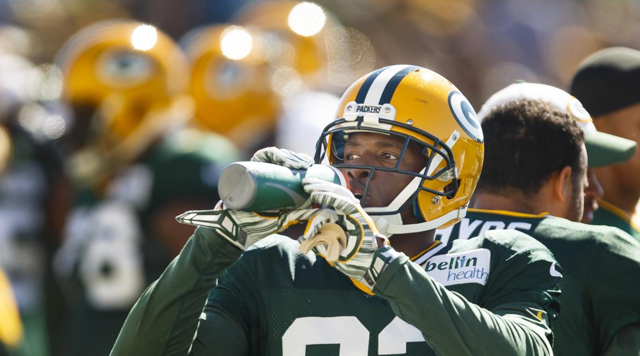 Green Bay Packers' Damarious Randall hydrates during NFL football training camp, Saturday, Aug. 1 , 2015, in Green Bay, Wis. (AP Photo/Mike Roemer)