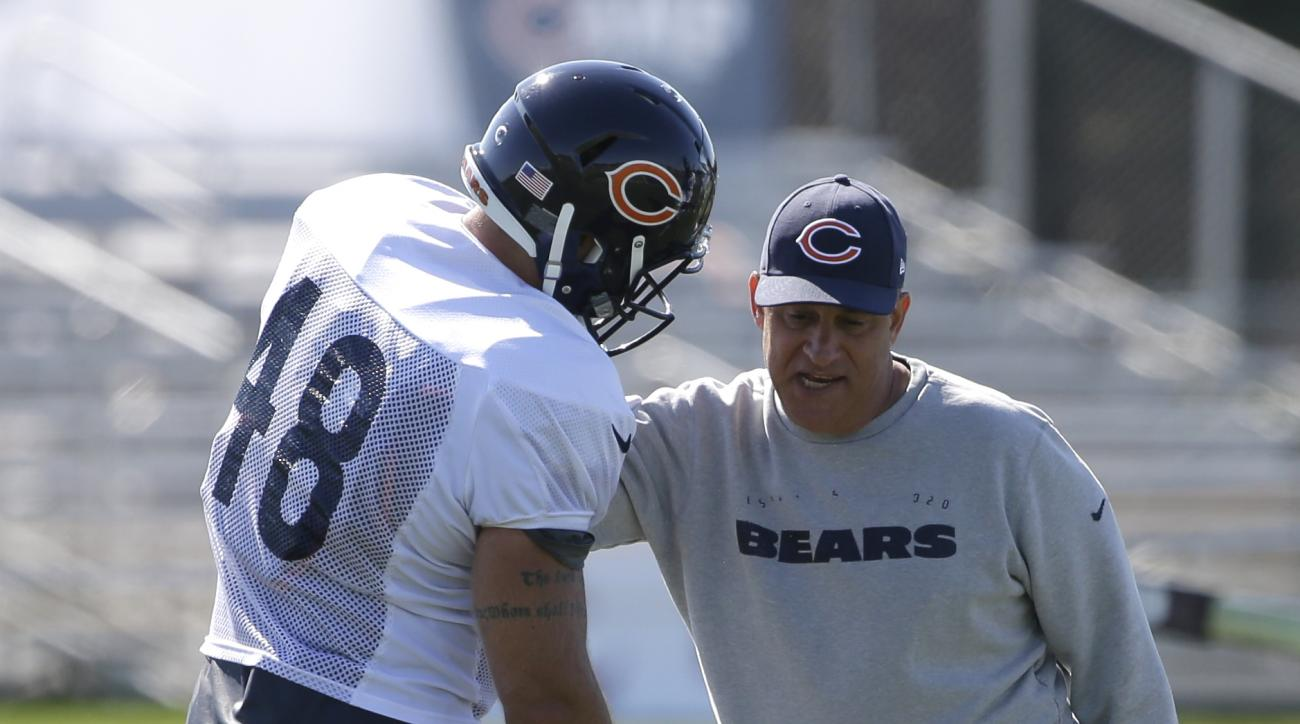 Chicago Bears defensive coordinator Vic Fangio, right, works with linebacker Kyle Woestmann during an NFL football training camp at Olivet Nazarene University, Saturday, Aug. 1, 2015, in Bourbonnais, Ill. (AP Photo/Nam Y. Huh)