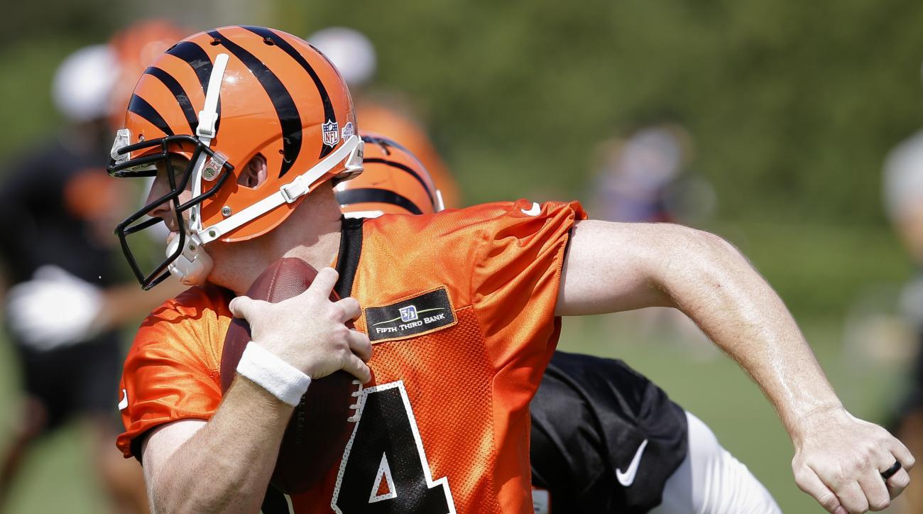 Cincinnati Bengals quarterback Andy Dalton participates in NFL football training camp, Saturday, Aug. 1, 2015, in Cincinnati. (AP Photo/John Minchillo)