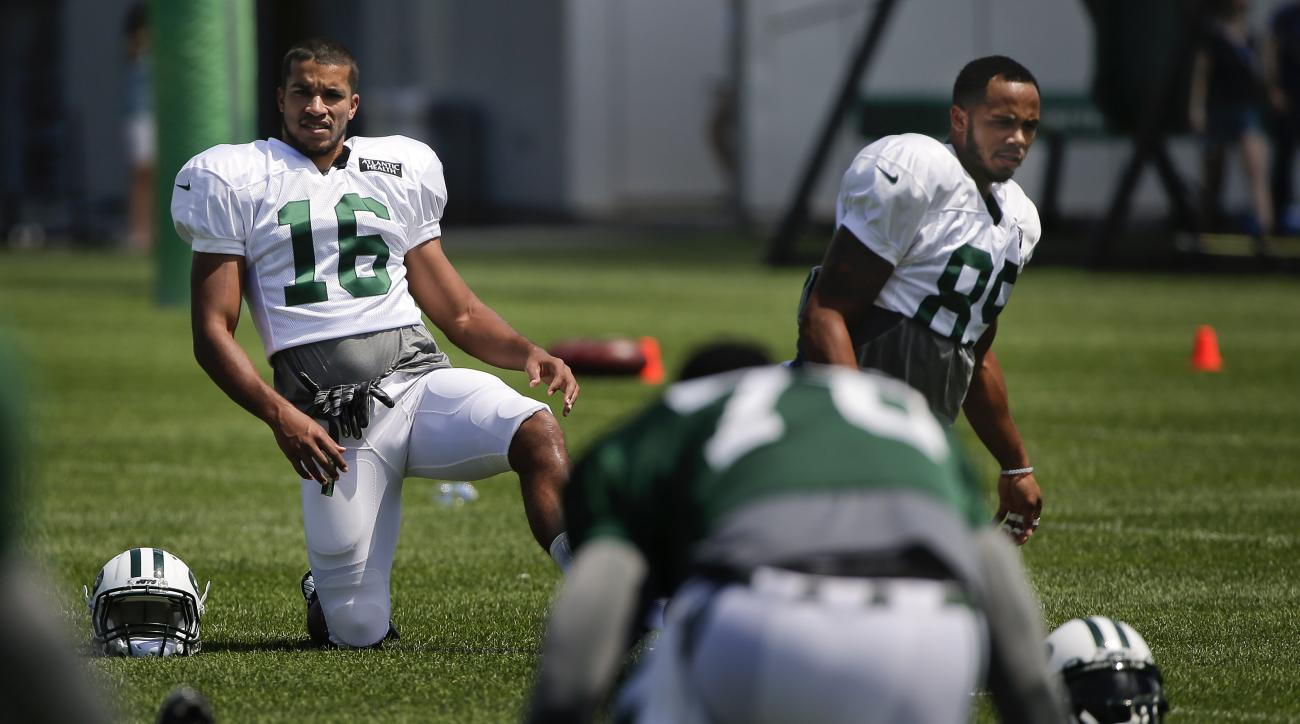 New York Jets wide receiver Austin Hill (16) and wide receiver DeVier Posey (89) stretch during the team's NFL football training camp, Saturday, Aug. 1, 2015, in Florham Park, N.J.. (AP Photo/Julie Jacobson)