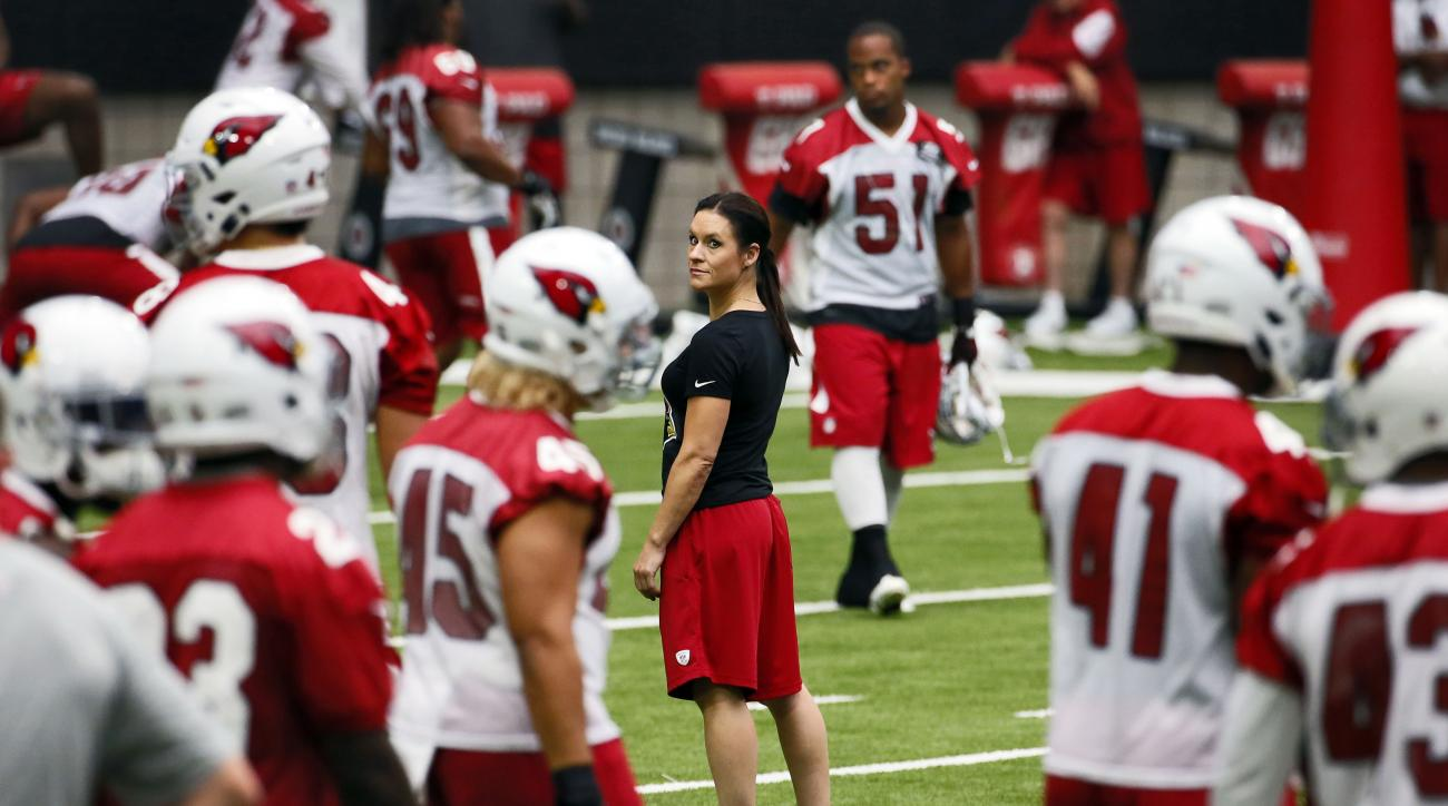 Arizona Cardinals' training camp coach Jen Welter stands at mid-field during an NFL football training camp, Saturday, Aug. 1, 2015, in Glendale, Ariz. (AP Photo/Matt York)