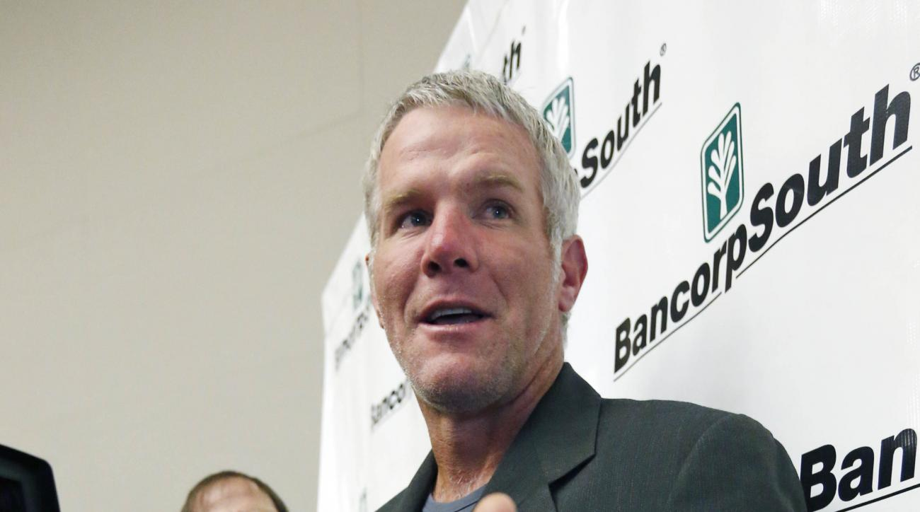 Former NFL quarterback Brett Favre, a Southern Mississippi alumnus speaks with reporters prior to his induction to the Mississippi Hall of Fame in Jackson, Miss., Saturday, Aug. 1, 2015. Favre joins a group of distinguished Mississippi athletes and coache