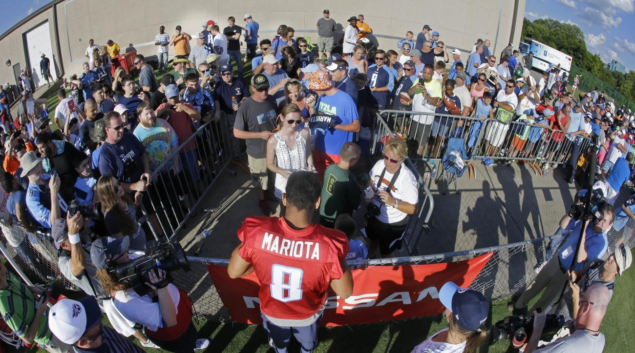 Fans line up for an autograph from Tennessee Titans quarterback Marcus Mariota (8) after NFL football training camp Saturday, Aug. 1, 2015, in Nashville, Tenn. (AP Photo/Mark Humphrey)