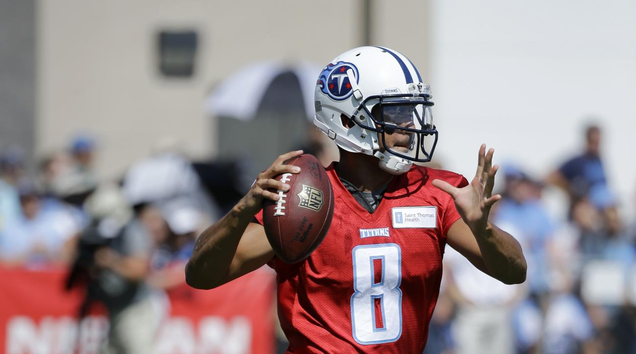 Tennessee Titans quarterback Marcus Mariota passes during NFL football training camp Saturday, Aug. 1, 2015, in Nashville, Tenn. (AP Photo/Mark Humphrey)