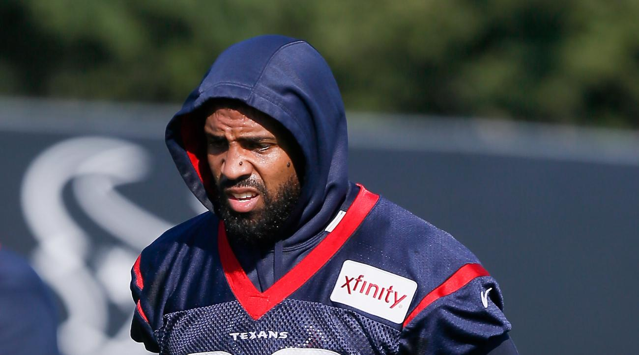 Houston Texans running back Arian Foster (23) walks from one field to another during an NFL football training camp at the Methodist Training Center on Sunday, Aug. 2, 2015 in Houston, Texas. (AP Photo/Bob Levey)