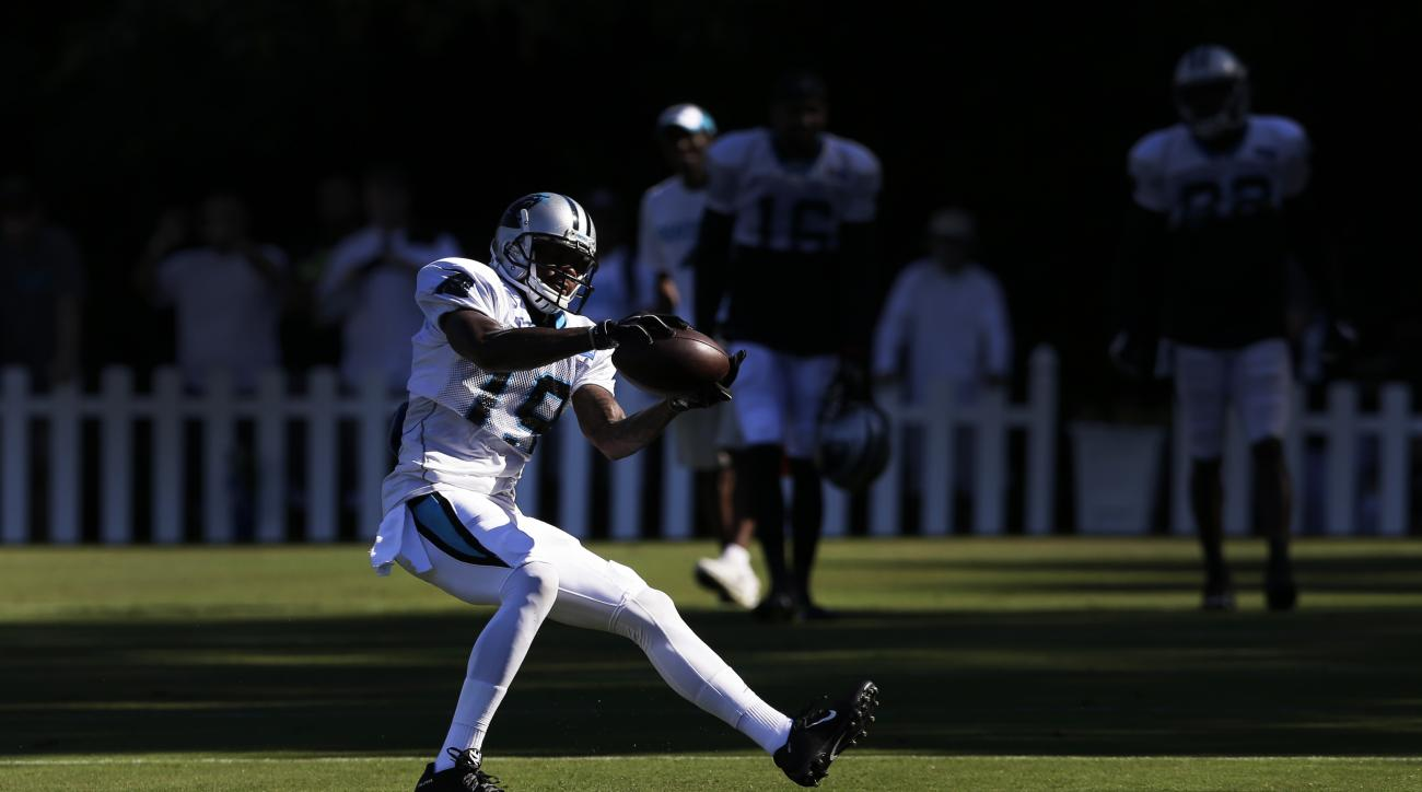 Carolina Panthers' Ted Ginn (19) catches a pass during the NFL football team's training camp in Spartanburg, S.C., Sunday, Aug. 2, 2015. (AP Photo/Chuck Burton)