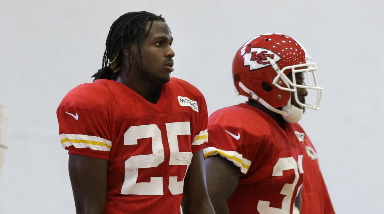 Kansas City Chiefs running back Jamaal Charles (25) rests between plays during NFL football training camp in St. Joseph, Mo., Monday, Aug. 3, 2015. (AP Photo/Orlin Wagner)
