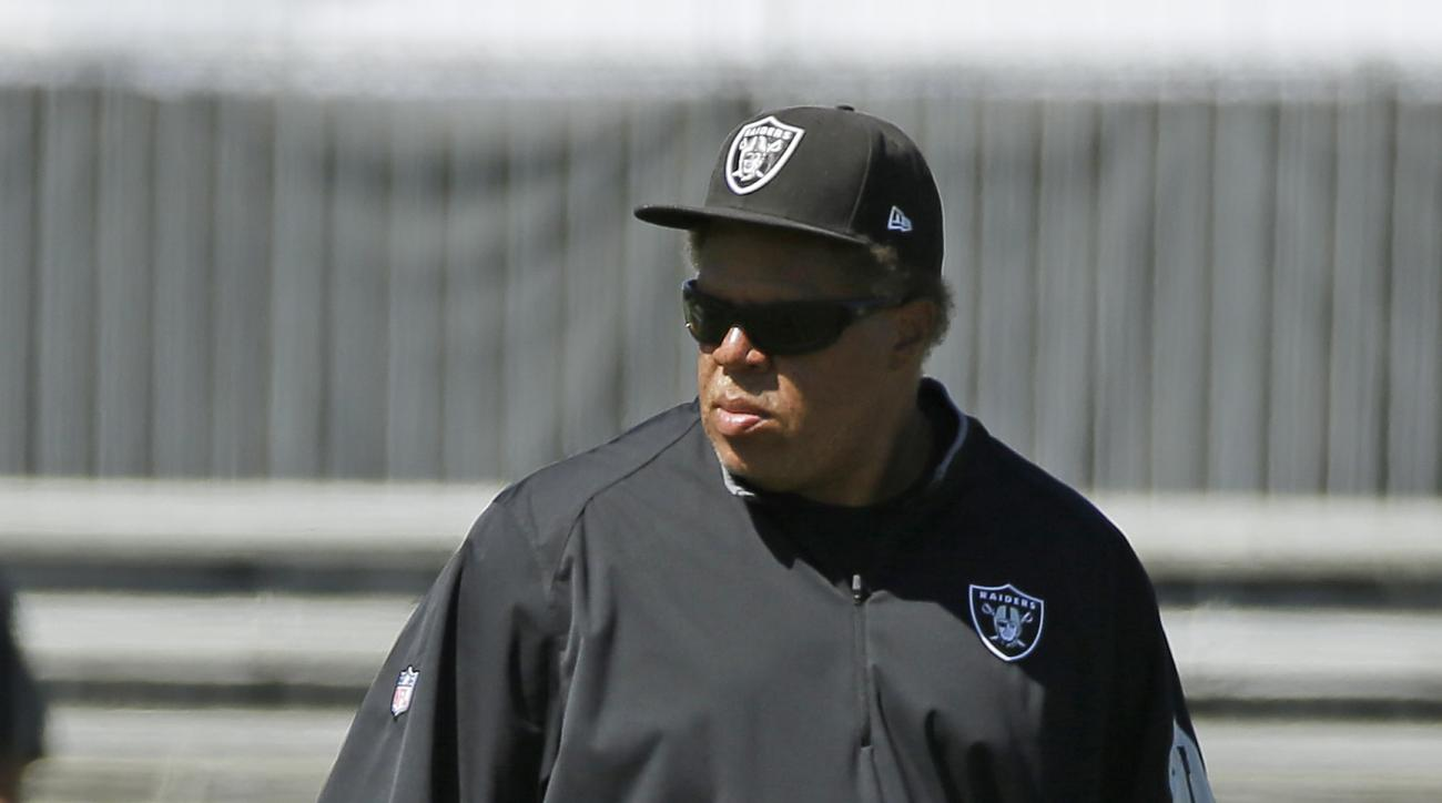 Oakland Raiders general manager Reggie McKenzie watches the team stretch during their football training camp Monday, Aug. 3, 2015, in Napa, Calif. (AP Photo/Eric Risberg)