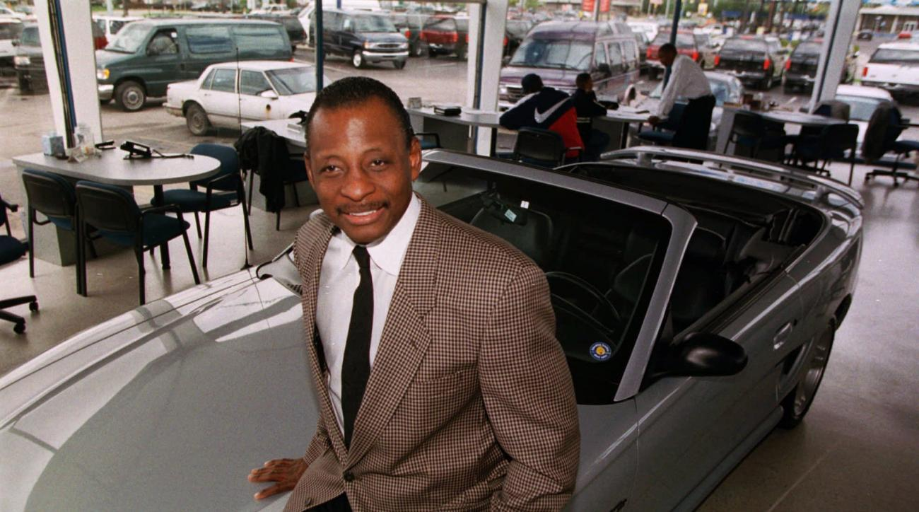 FILE - In this Sept. 30, 1997, file photo, Mel Farr poses in his showroom in Oak Park, Mich. Farr, the Detroit Lions' running back who rushed for over 3,000 yards in seven NFL seasons, has died. He was 70. A Lions spokesman said Farr's son confirmed his f