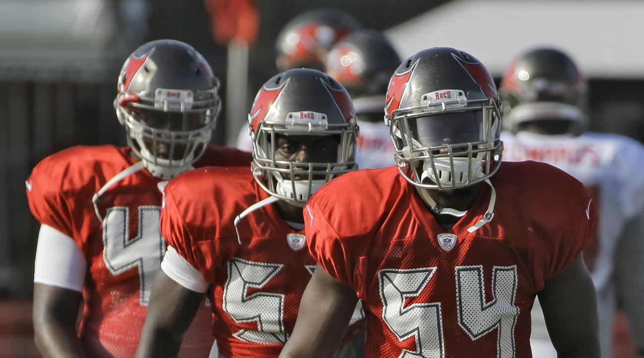 Tampa Bay Buccaneers outside linebacker Lavonte David (54) stretches with teammates during NFL football training camp, Tuesday, Aug. 4, 2015, in Tampa, Fla. (AP Photo/Chris O'Meara)