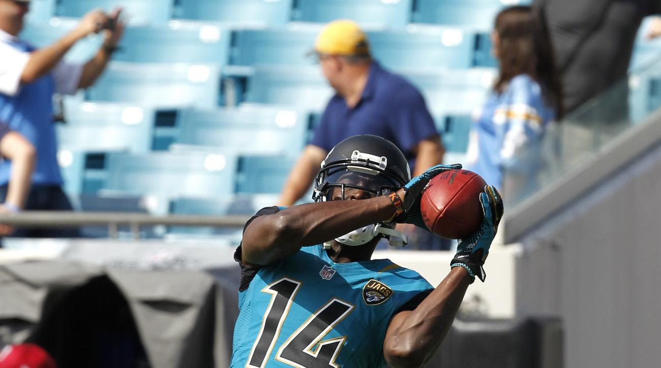Jacksonville Jaguars' wide receiver Justin Blackmon (14) catches a pass during pre game warmups before the game against the San Diego Chargers at EverBank Field in Jacksonville, Sunday, October 20, 2013. (AP Photo/Chris Covatta)