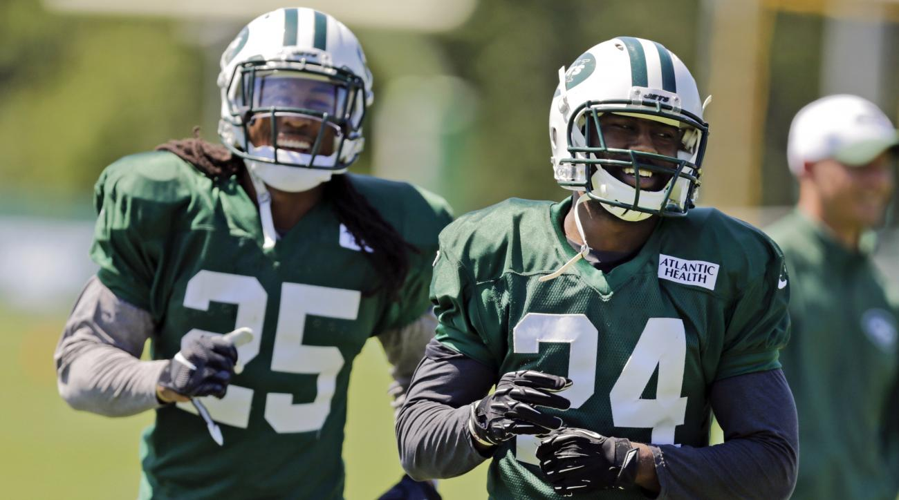 New York Jets defensive back Darrelle Revis (24) and Calvin Pryor (25) smile as they take part in drills during practice at NFL football training camp, Tuesday, Aug. 4, 2015, in Florham Park, N.J. (AP Photo/Frank Franklin II)