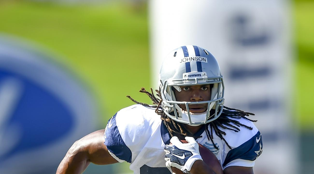 Dallas Cowboys running back Gus Johnson runs a drill during Dallas Cowboys' NFL training camp, Tuesday, Aug. 4, 2015, in Oxnard, Calif. (AP Photo/Gus Ruelas)