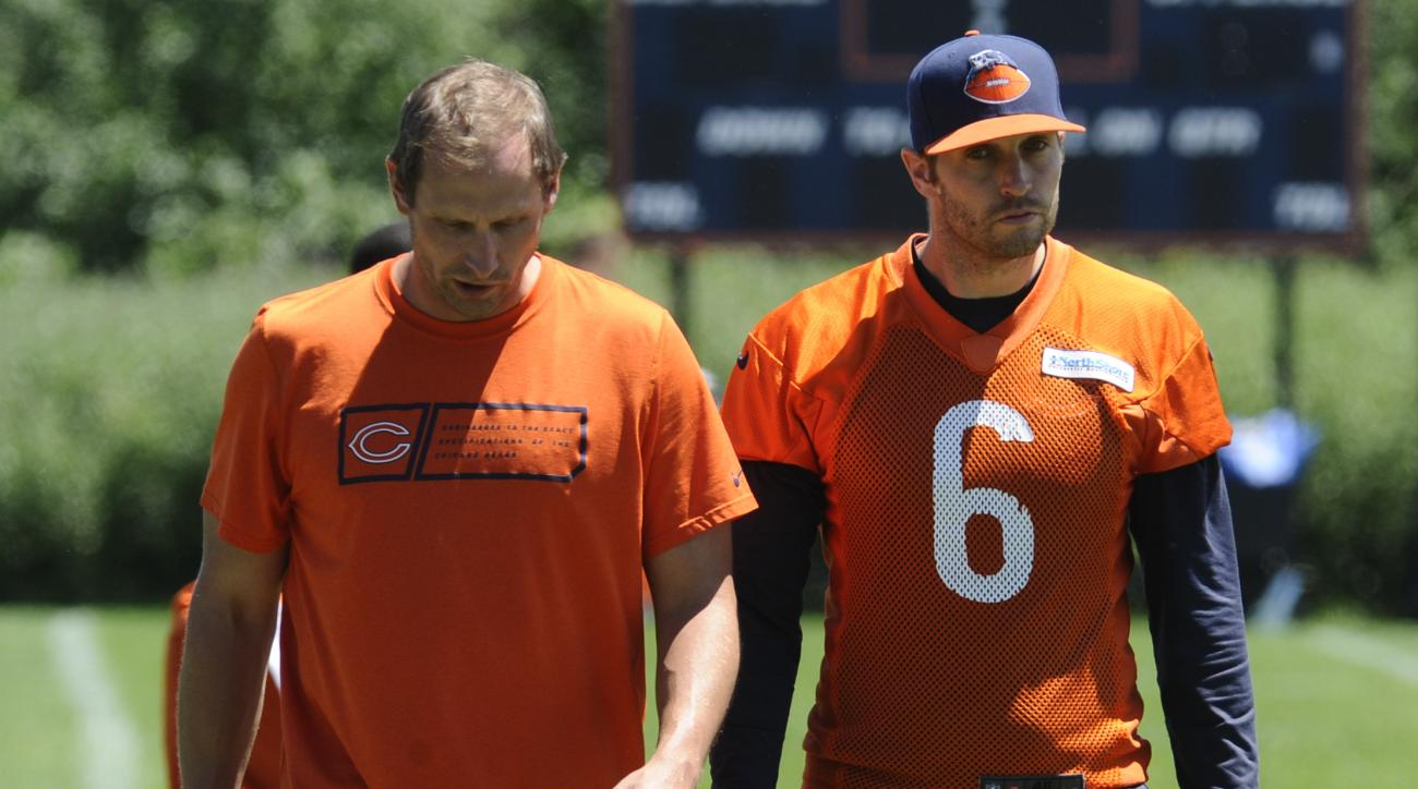 FILE - In this June 16, 2015, file photo, Chicago Bears quarterback Jay Cutler, right, and offensive coordinator Adam Gase  walk together after NFL football minicamp  in Lake Forest, Ill. Gase is quarterback Cutler's fifth coordinator with the Bears and s