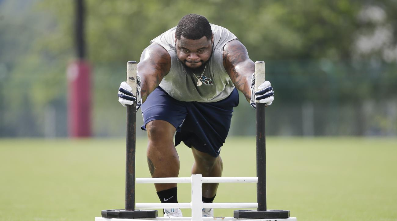 Tennessee Titans nose tackle Sammie Hill pushes a sled as he works to recover from a knee injury during NFL football training camp Wednesday, Aug. 5, 2015, in Nashville, Tenn. (AP Photo/Mark Humphrey)
