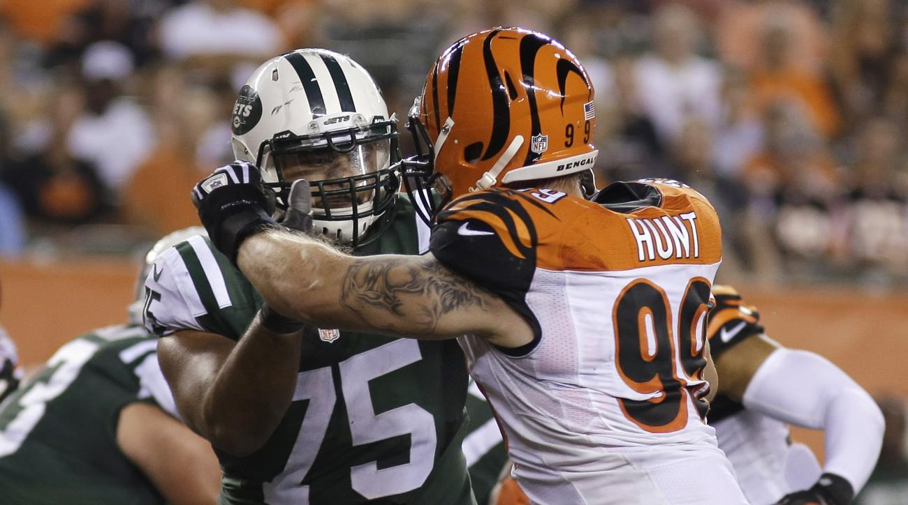 FILE - In this Aug. 16, 2014, file photo, Cincinnati Bengals defensive end Margus Hunt (99) rushes New York Jets offensive tackle Oday Aboushi (75) during an NFL preseason football game in Cincinnati. Willie Colon is the incumbent at right guard for the J