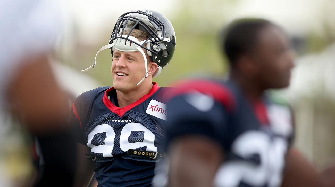 Houston Texans' J.J. Watt gets ready for practice at an NFL training camp Thursday, Aug. 6, 2015, in Richmond, Va. The Washington Redskins and Houston Texans begin three days of joint workouts at the Redskins' training complex. (Rob Ostermaier/The Daily P