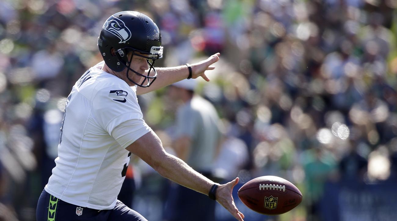 Seattle Seahawks kicker Jon Ryan practices at an NFL football training camp Thursday, Aug. 6, 2015, in Renton, Wash. (AP Photo/Elaine Thompson)