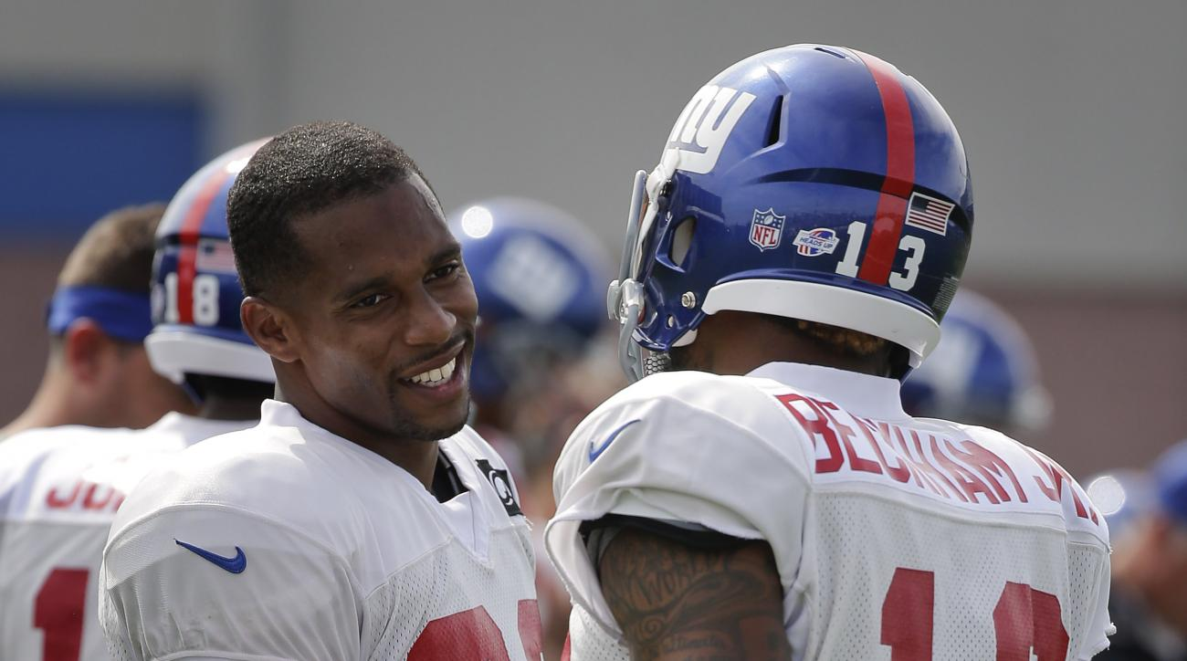 New York Giants wide receiver Victor Cruz (80) greets wide receiver Odell Beckham (13) during the team's NFL football training camp, Thursday, Aug. 6, 2015, in East Rutherford, N.J. (AP Photo/Julie Jacobson)