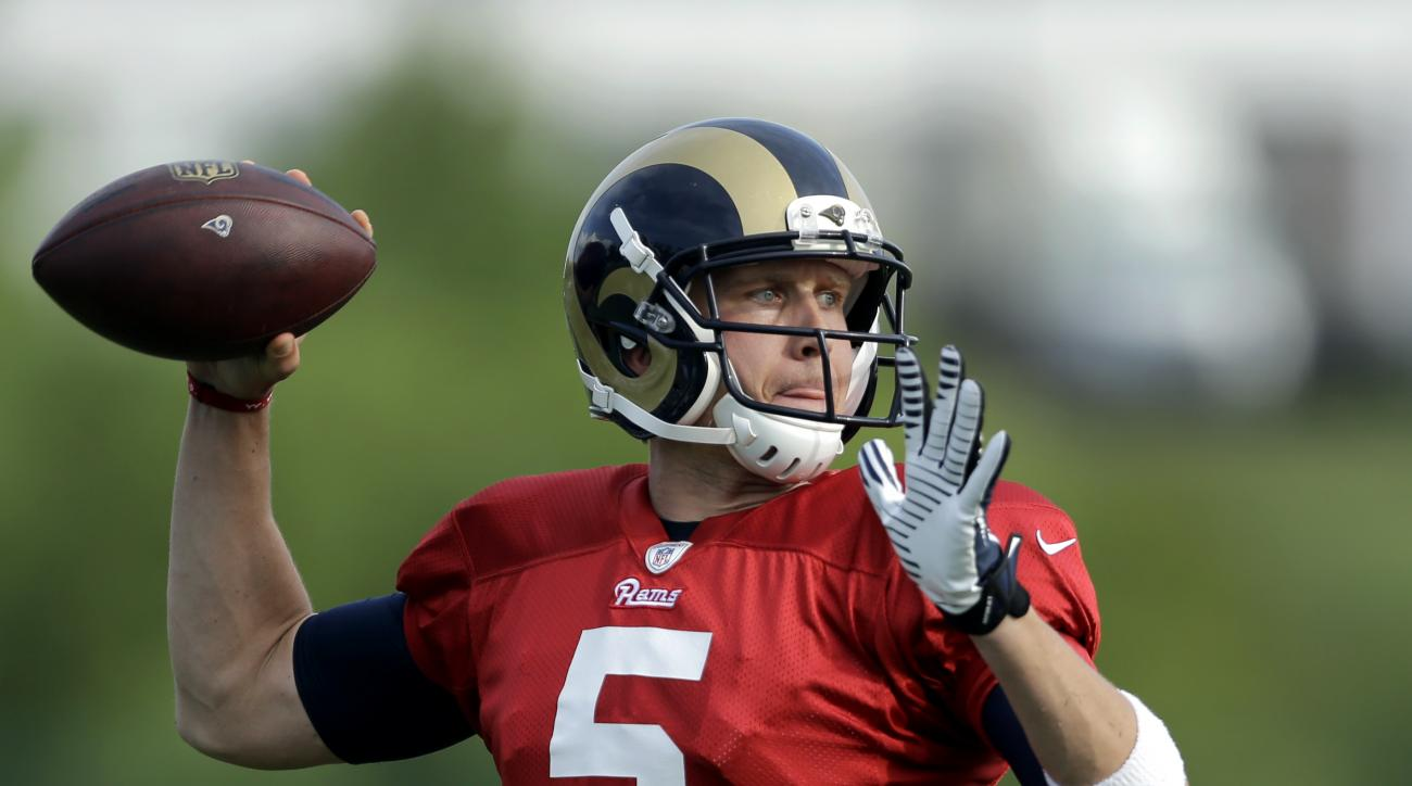 St. Louis Rams quarterback Nick Foles throws during training camp at the NFL football team's practice facility Thursday, Aug. 6, 2015, in St. Louis. (AP Photo/Jeff Roberson)
