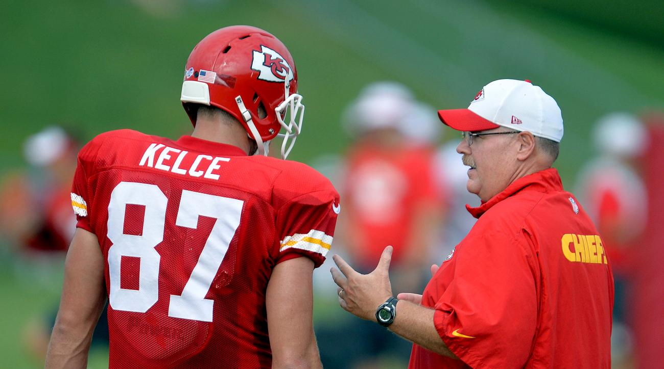 Kansas City Chiefs tight end Travis Kelce talks with Chiefs head coach Andy Reid during NFL football training camp, Friday, Aug. 7, 2015, in St. Joseph, Mo. (Andrew Carpenean/The St. Joseph News-Press via AP) MANDATORY CREDIT