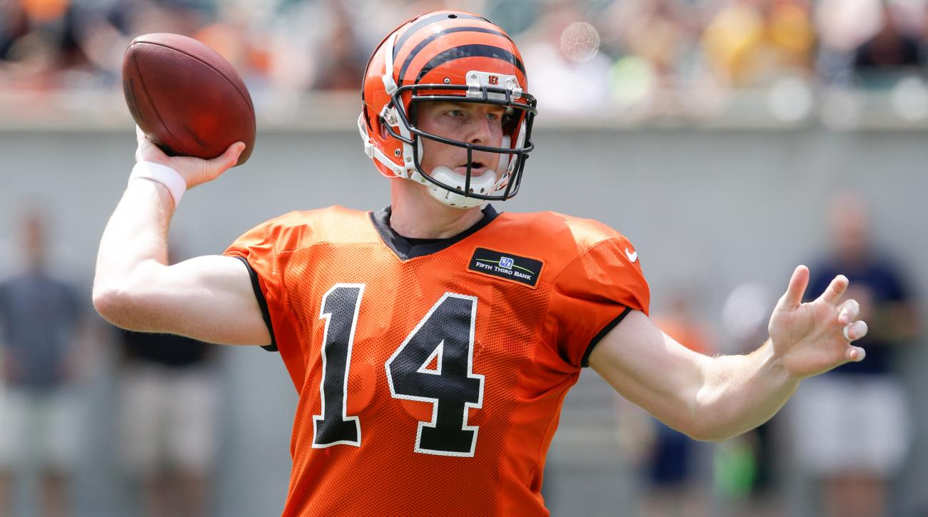 Cincinnati Bengals quarterback Andy Dalton attempts a pass during a scrimmage in NFL football training camp, Saturday, Aug. 8, 2015, in Cincinnati. (AP Photo/John Minchillo)