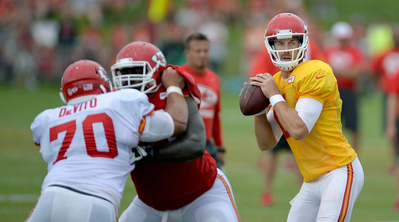 Kansas City Chiefs quarterback Alex Smith, right, looks to pass during NFL football training camp Saturday, Aug. 8, 2015, in St. Joseph, Mo. (Andrew Carpenean/The St. Joseph News-Press via AP) MANDATORY CREDIT