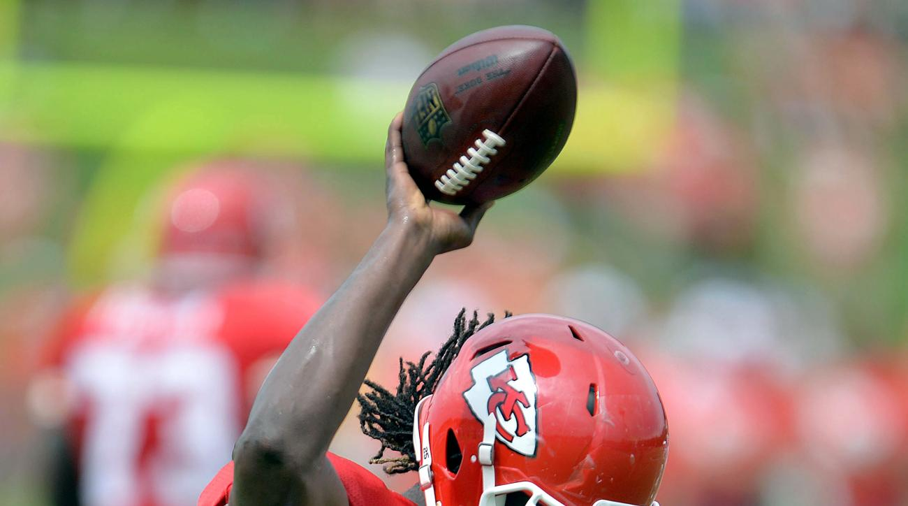 Kansas City Chiefs running back  Jamaal Charles holds up the ball after scampering into the end zone during NFL football training camp Saturday, Aug. 8, 2015, in St. Joseph, Mo. (Andrew Carpenean/The St. Joseph News-Press via AP) MANDATORY CREDIT