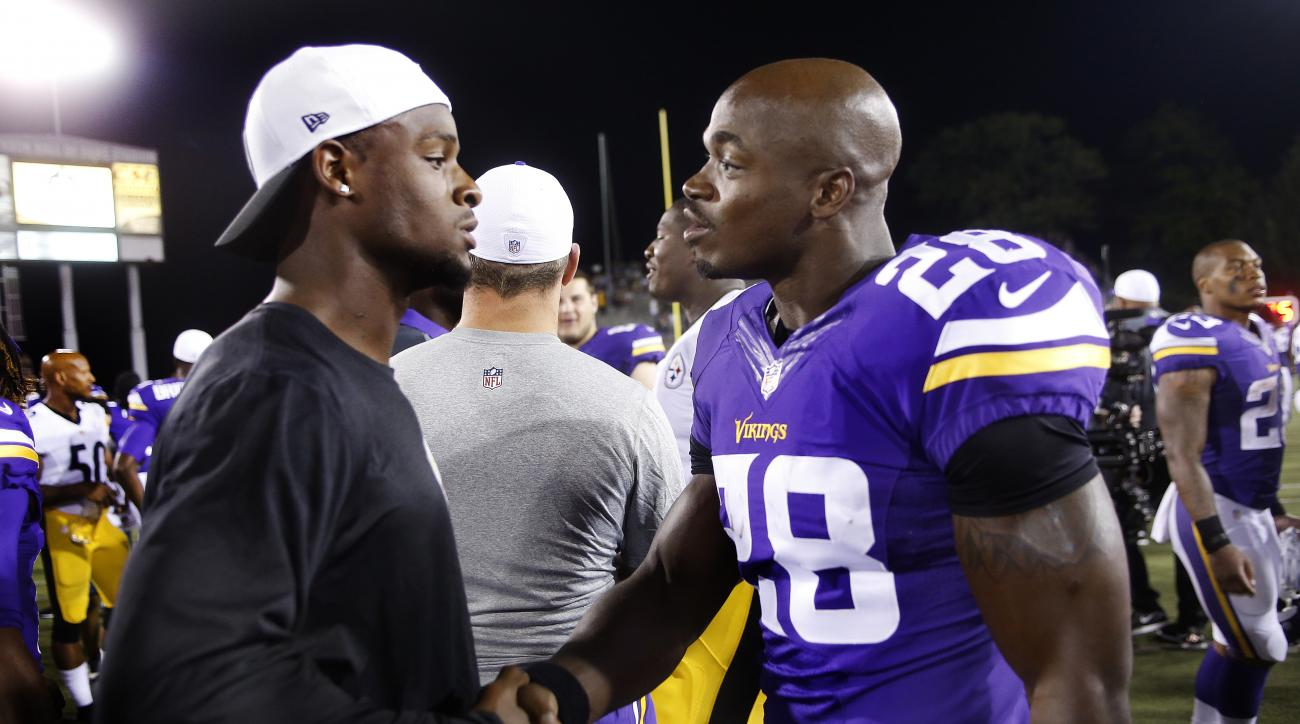 Minnesota Vikings running back Adrian Peterson, right, visits with Pittsburgh Steelers running back Le'Veon Bell, left, on the field after an NFL preseason football game in Canton, Ohio,  Sunday, Aug. 9, 2015. The Vikings won 14-3. (AP Photo/Tom E. Puskar