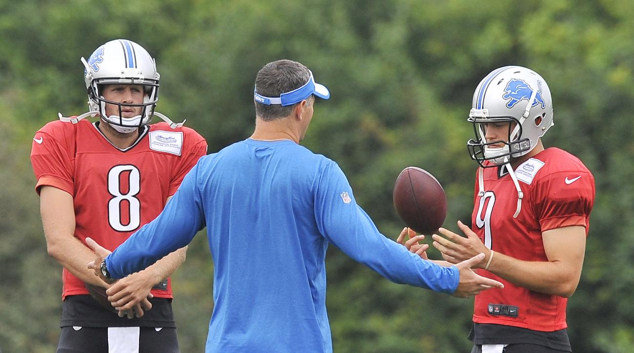 Detroit Lions NFL football team offensive coordinator Joe Lombardi talks with his quarterbacks Dan Orlovsky (8) and Matthew Stafford (9) at the teams training camp in Allen Park, Mich., Monday, Aug. 10, 2015. (Daniel Mears/The Detroit News via AP) DETROIT